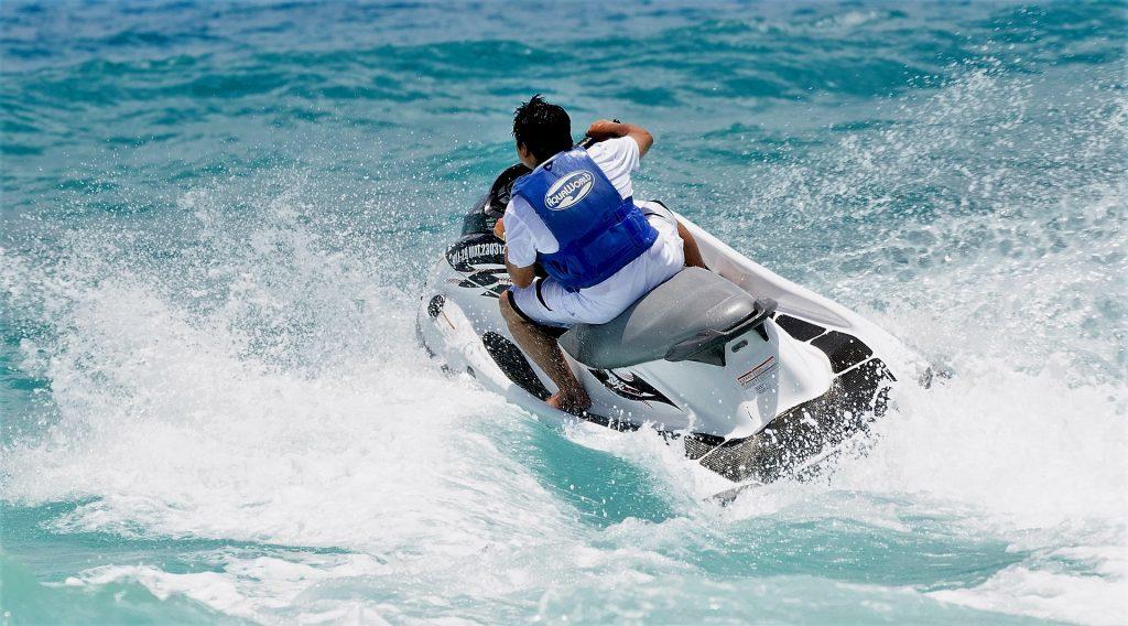 guy riding a jet ski in blue waters in zante