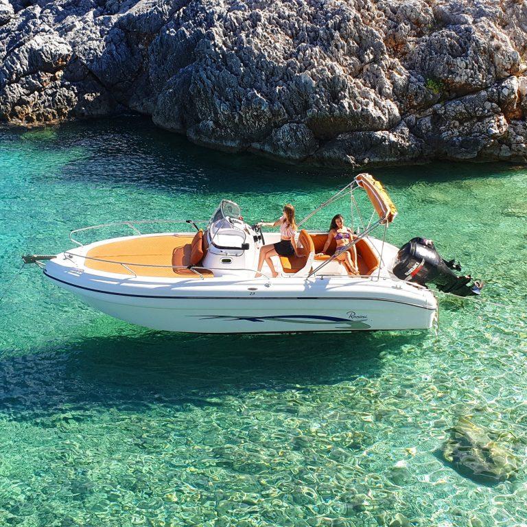 2 girls in a luxury speedboat in crystal clear waters of Zakynthos
